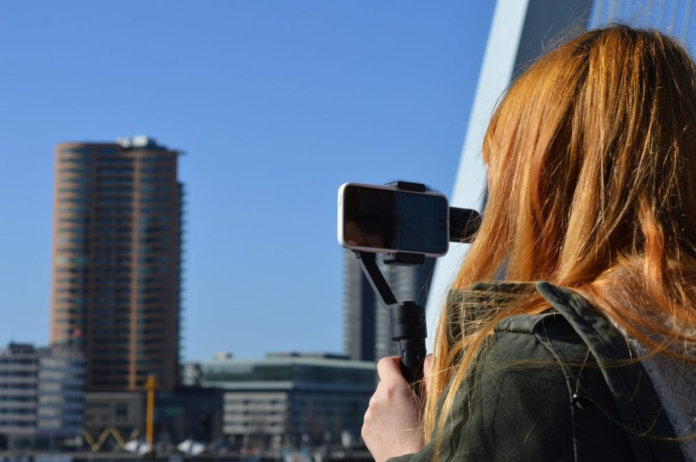 Woman taking a video with an iPhone.